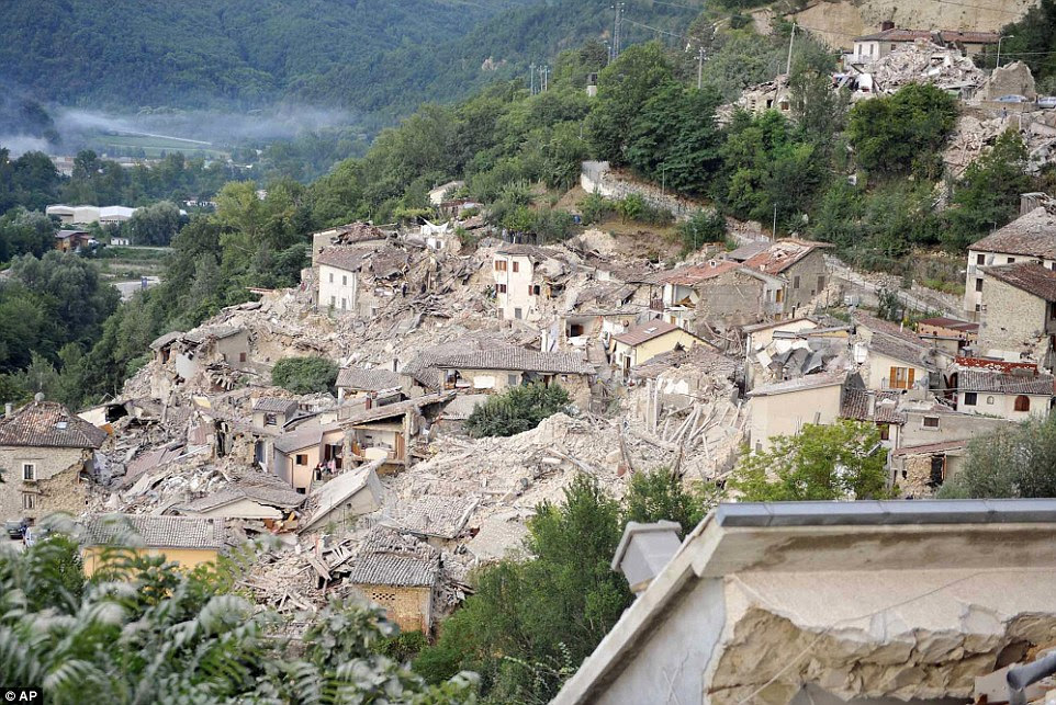 In ruins: Barely any buildings remain intact in the town of Pescara del Tronto after the devastating earthquake