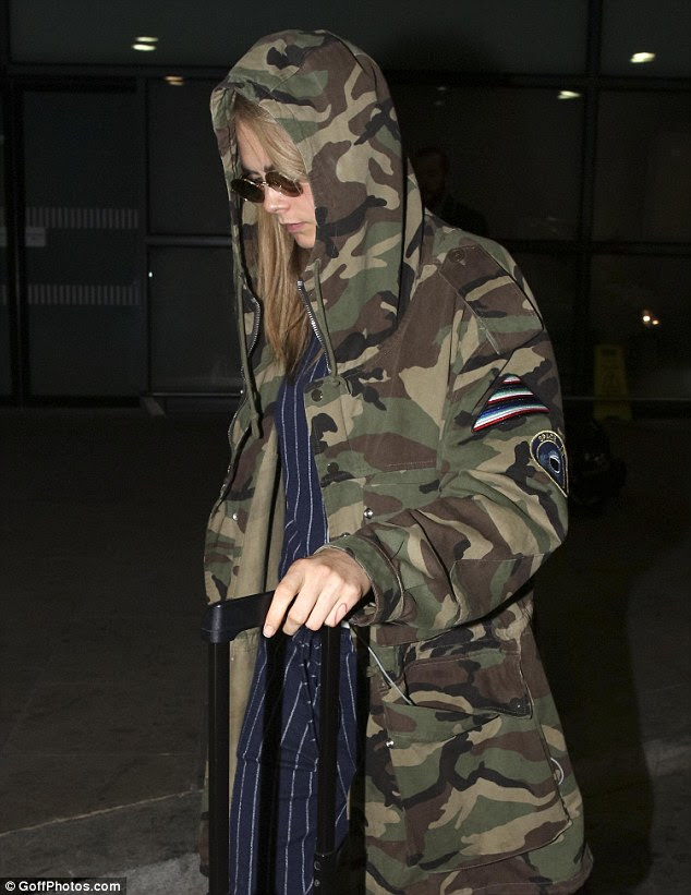 Cool Cara:Making sure to put her own spin on the outfit, Cara wrapped up warm with a large army printed coat, which emphasised the eccentricity of the outfit
