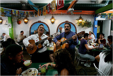 Mariachi singers entertain guests at the  Old Town Mexican Café.