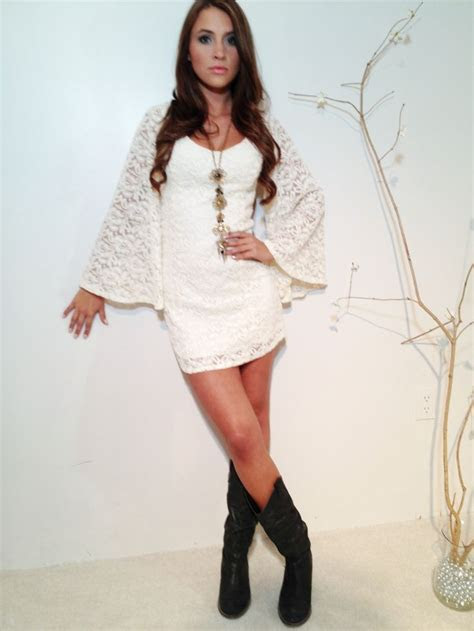 White lace dress with cowboy boots . A fun twist for an