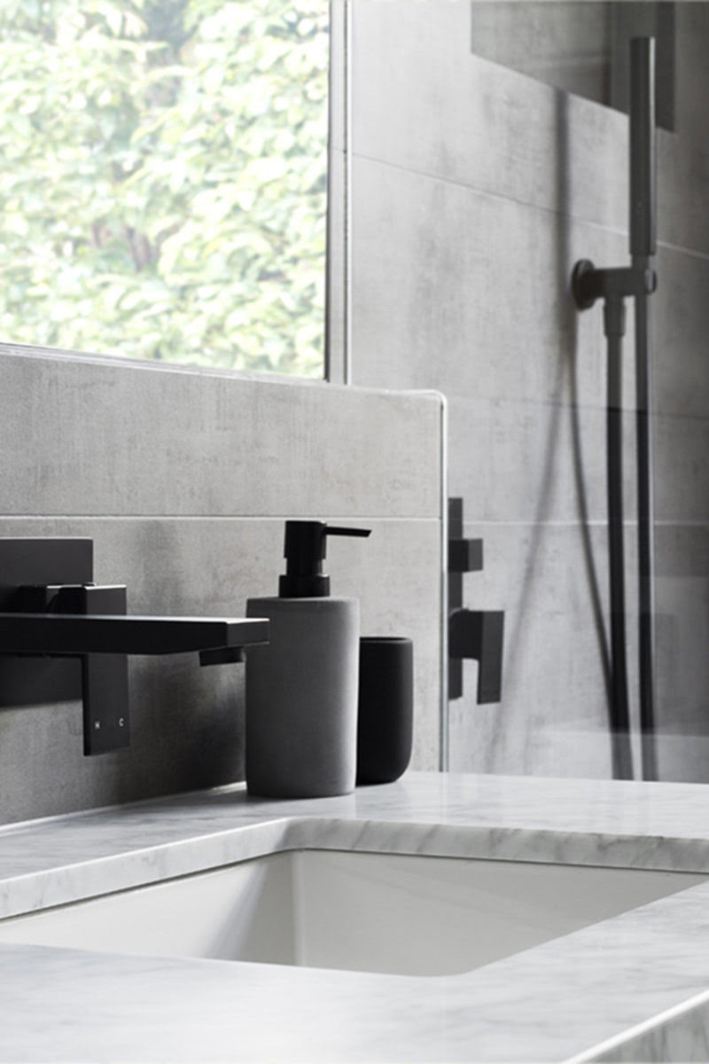 Matte Black Accents Add Sophistication To This Grey And White