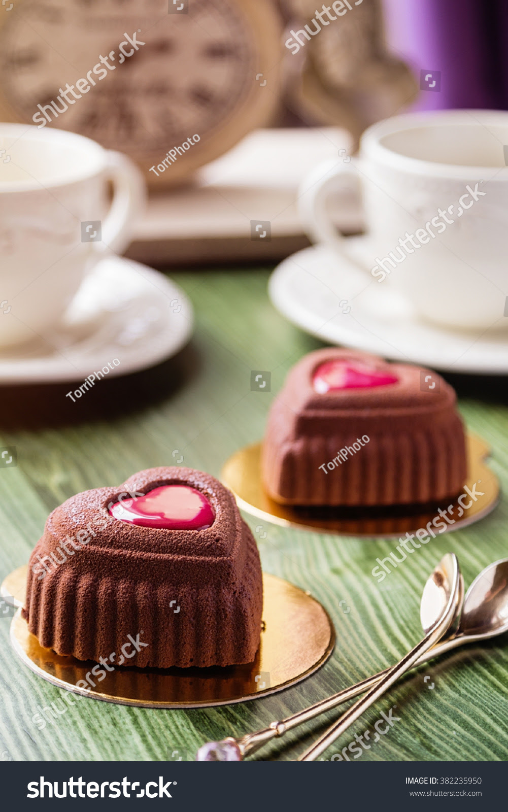 http://www.shutterstock.com/en/pic-382235950/stock-photo-heart-shaped-mini-mousse-cakes-covered-with-chocolate-velour-with-cup-of-coffee-on-green-table-in.html
