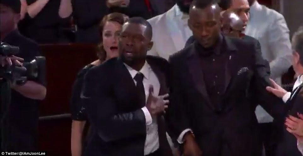 Actor Trevante Rhodes grabbed as his heart as he walked towards the stage to accept the award on Sunday
