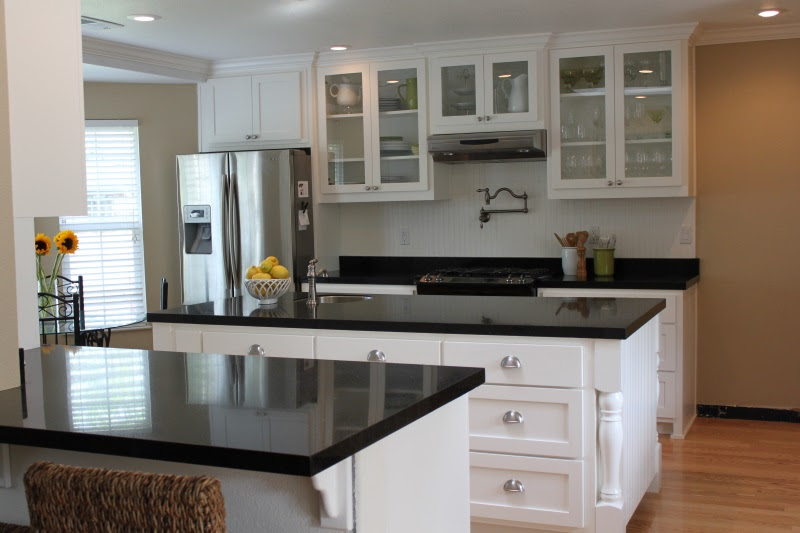 White Kitchen Cabinets with Black Granite Countertops ...
