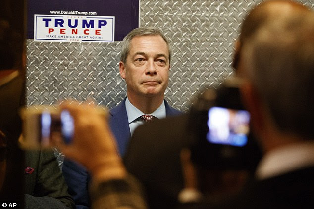 Pictured, Mr Farage is snapped by photographers as he stands in a lift at Trump Tower