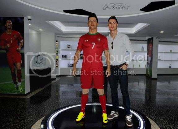 Cristiano Ronaldo poses with his new waxwork inside the new museum in Funchal, Madeira