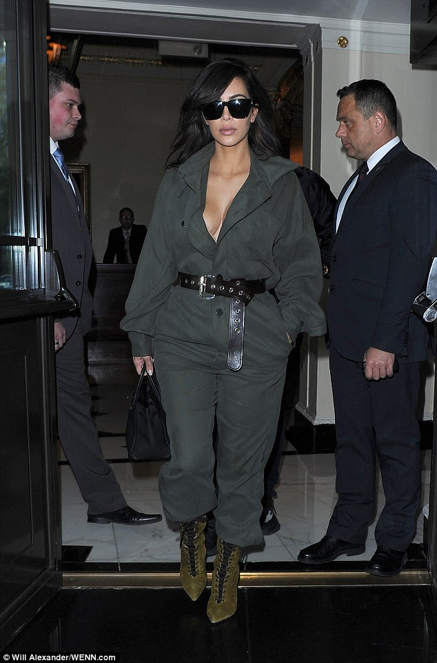 Stunner: Kim flashed her cleavage in the quirky boilersuit as she left her London hotel and prepared to head to Heathrow airport earlier in the day