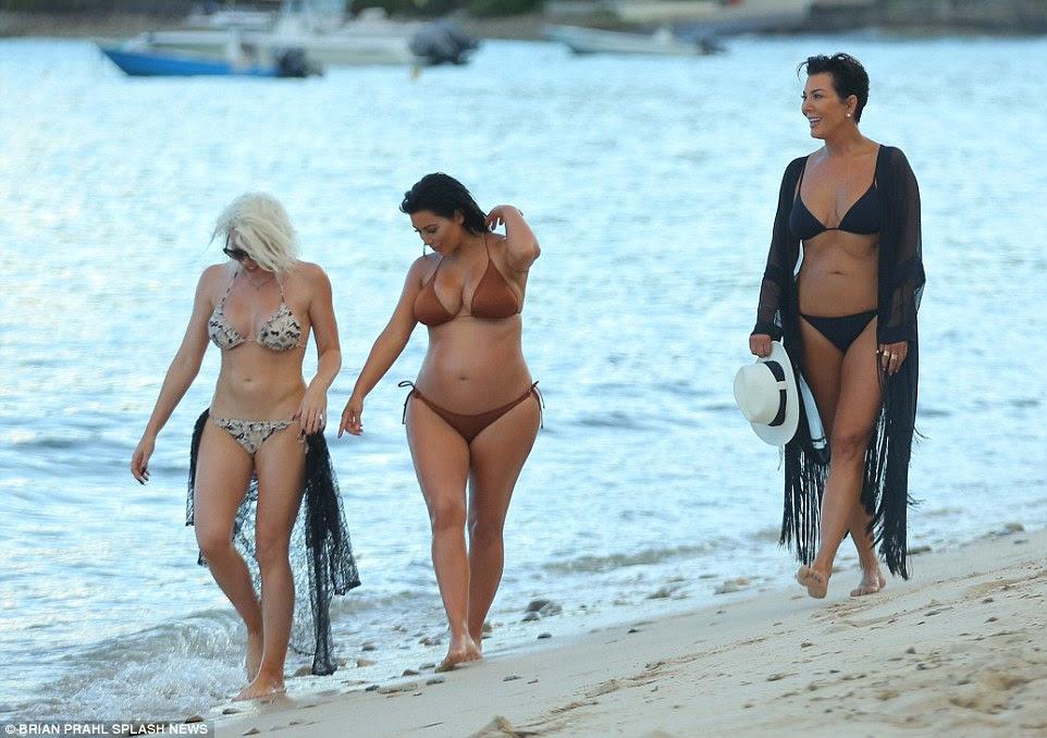 Procurando incrível: Kim apareceu muito confiável corpo enquanto ela modelou suas curvas na luz do sol