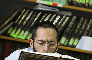 A religious Jewish Kabbalah (Jewish mysticism) scholar reads from the Talmud holy book during his studies at leading Kabbalist Rabbi Yitzhak Kadouri's synagogue August 4, 2004 in Jerusalem, Israel.