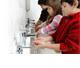children washing their hands at a school bathroom