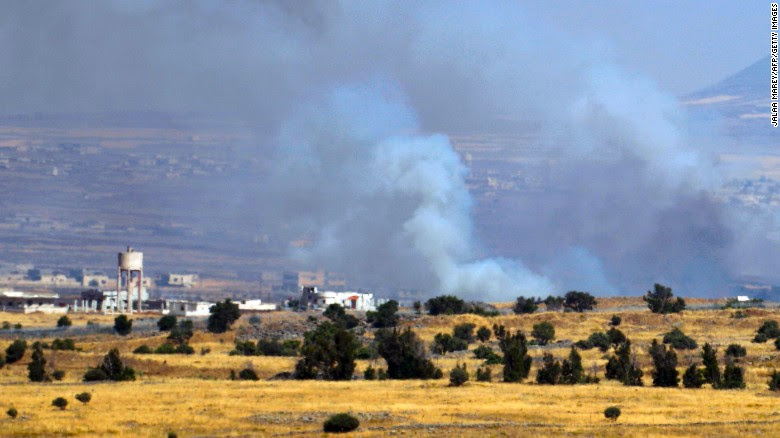 This picture taken from the Israeli-occupied Golan Heights shows smoke billowing from the Syrian side of the border on June 24, 2017.