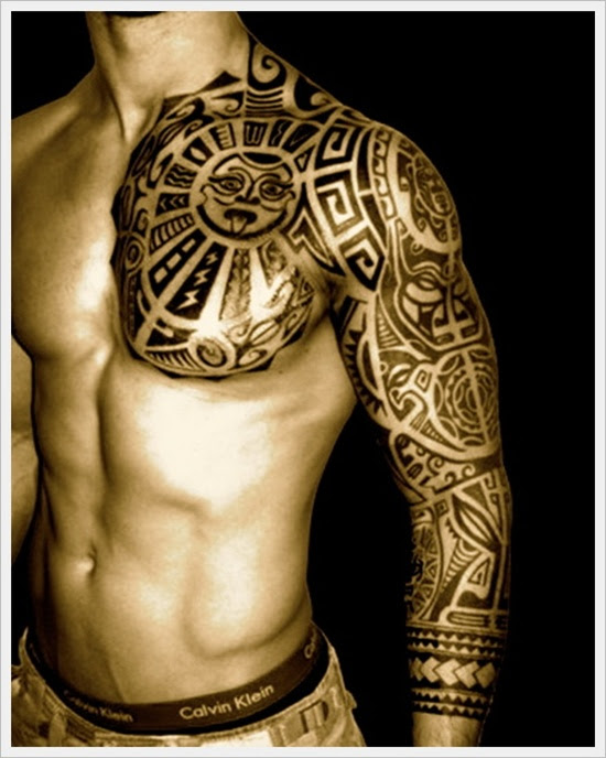 Tribal Sun Tattoo On Full Sleeve And Front Shoulder