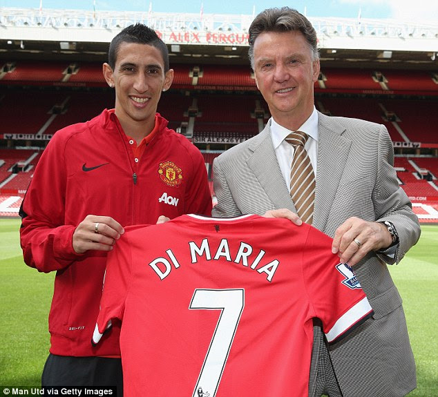 Di Maria (left) poses with the No 7 shirt last summer upon his £60m arrival to the club from Real Madrid