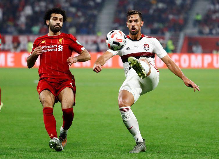 Soccer Football - Club World Cup - Final - Liverpool v Flamengo - Khalifa International Stadium, Doha, Qatar - December 21, 2019  Flamengo's Pablo Mari in action with Liverpool's Mohamed Salah   REUTERS/Kai Pfaffenbach