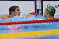 Michael Phelps (L) of the U.S. congratulates South Africa's Chad le Clos after the latter won the men's 200m butterfly final during the London 2012 Olympic Games at the Aquatics Centre July 31, 2012. Phelps won silver in the event. REUTERS/Toby Melville