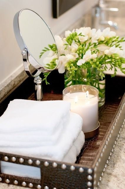 Freesia and towels with candle Via awinndesign.blogspot.com
