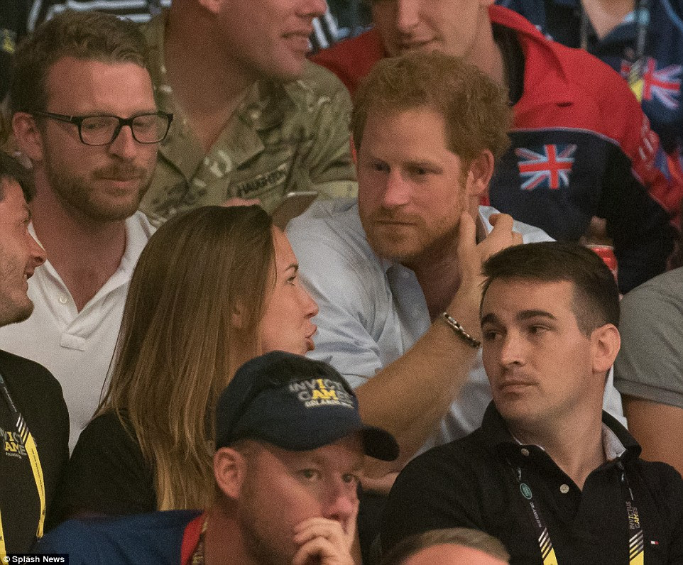 Prince Harry listens intently during the game which involved Derek Hough with teams coached by  John Cena and Wilmer Valderrama, Invictus Games, Orlando