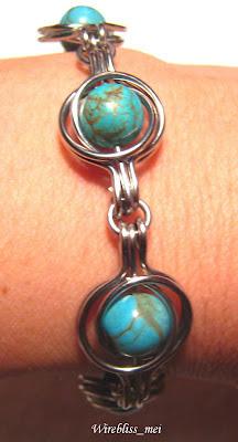 Turquoise Wire Wrap Bracelet around wrist