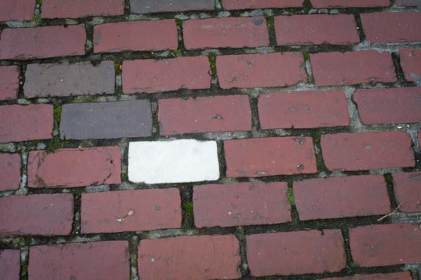 Edgartown News, Old Whaling Church, Edgartown Wood Shop, Porch Shadows, white brick in Edgartown sidwalk