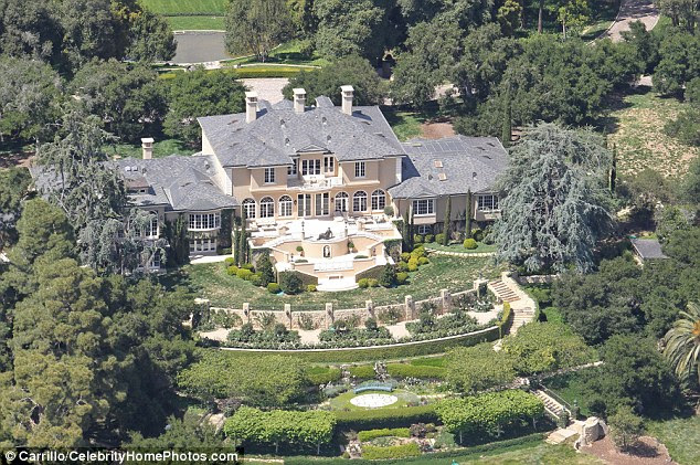 Lavish spread: Oprah splashed out $50 million for her 23,000 square-feet property that stands on 42 acres in Montecito, CA, back in 2001 and recently bought the 23-acre equestrian estate next door for $28.9 million