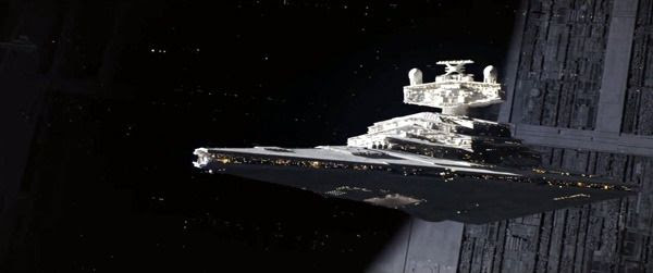A Star Destroyer cruises above the Death Star in ROGUE ONE: A STAR WARS STORY.