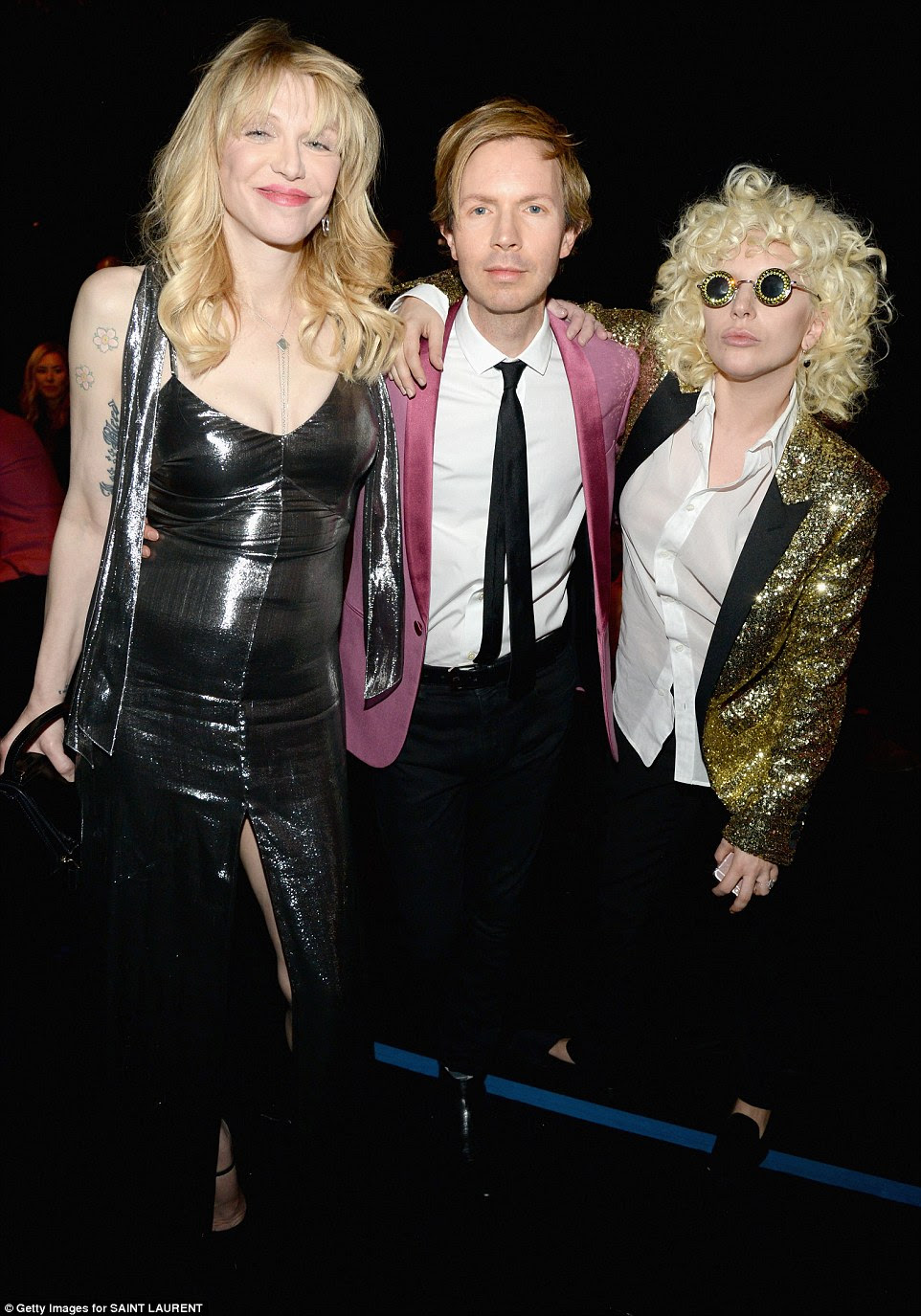 Fashionable trio: Gaga chatted with singer Beck and rocker Courtney Love, who both also wore Saint Laurent