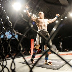 Chad Jordan celebrates after winning by knockout against Mike Robinson during the 165-pound matchup.