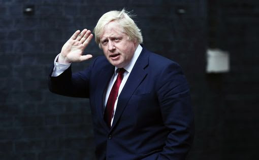 Boris Johnson heads into No.10 and soon emerges as the new Foreign Secretary