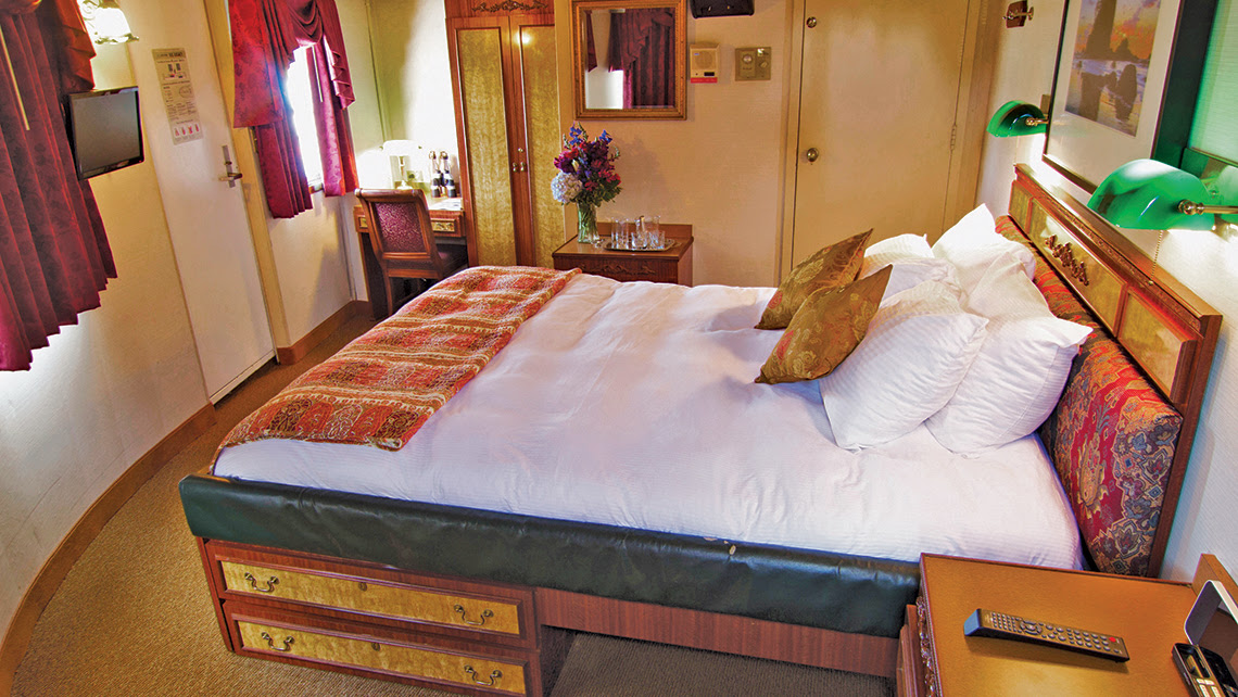 The cabins on coastal cruise ships tend to be small and cozy, like this one on the Legacy.