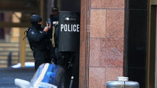 Police ready to storm the Lindt cafe in Martin Place Picture: Toby Zerna