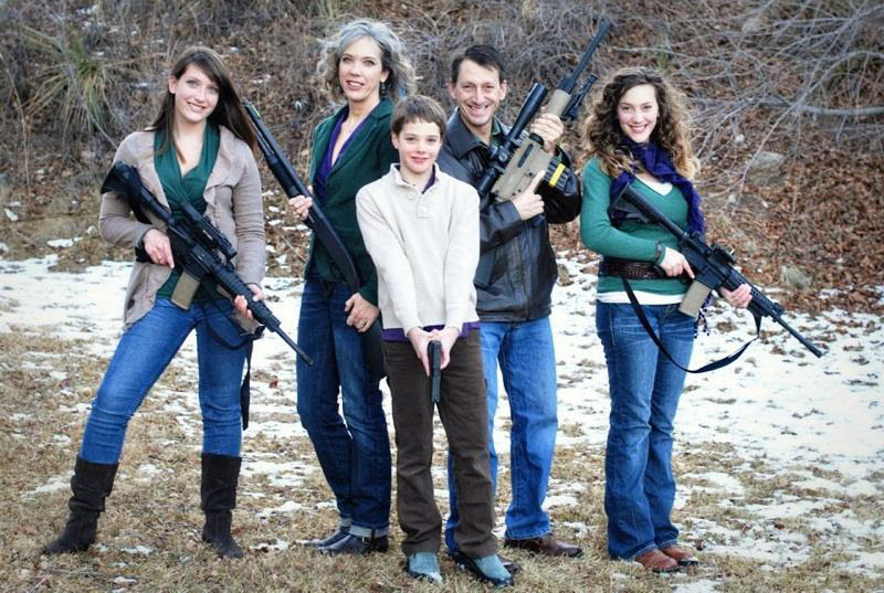 http://bigmedia.org/wp-content/uploads/Greg-Brophy-family-photo-with-daughters-gun-pointed-at-son.jpg