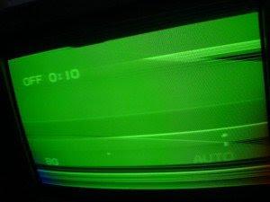 televisi sanyo warna hijau bergaris