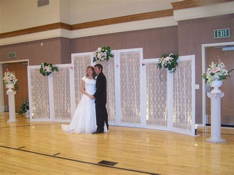 sheer material and twinkle lights for wedding altar