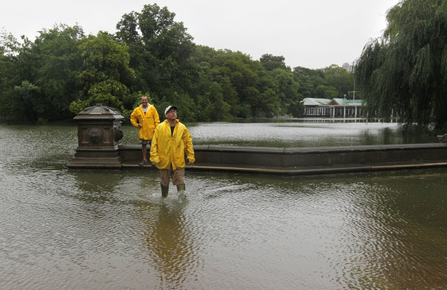 Jimmy Kaplow, left, and David Korostoff, both of New York, step through standing water at the Bethesda Fountain area in New York's Central Park as Tropical Storm Irene passes through the city, Sunday,