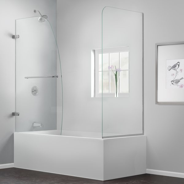 A minimalist bathroom idea with white built in bathtub with frameless transparent glass panels a wall mount showerhead