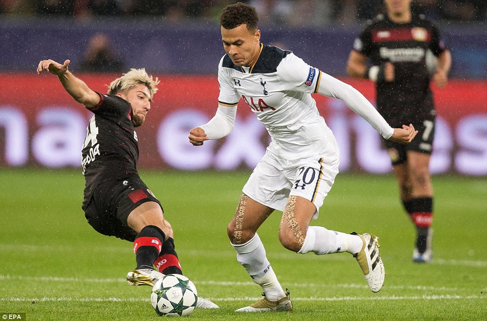 Winger Kevin Kampl loses his balances as he fails in his attempts to stop Alli who races forward with the ball