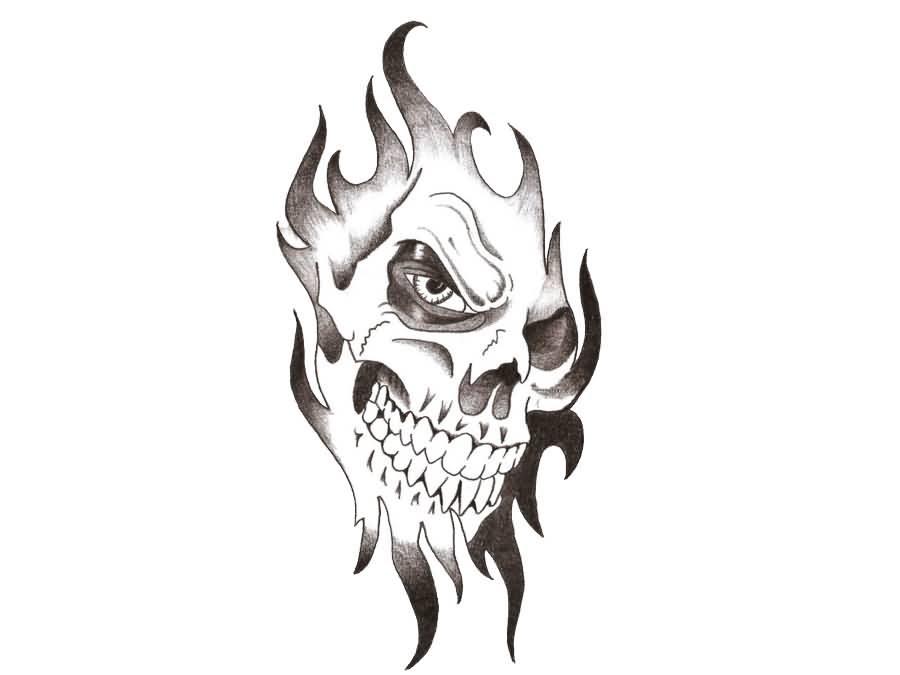 Skull Face In Tribal Tattoo Design