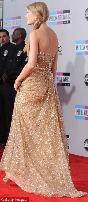 Golden Girl: Taylor Swift donned a floor-length golden gown covered in sequins