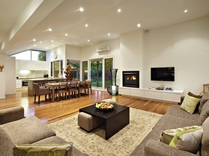 Open plan living room using beige colours with floorboards ...