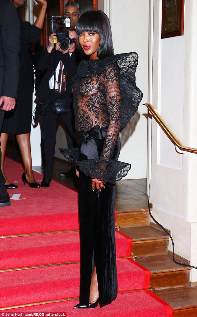 Turning heads: The top model, 45, looked sensational in a black gown which featured an almost completely sheer lace top half