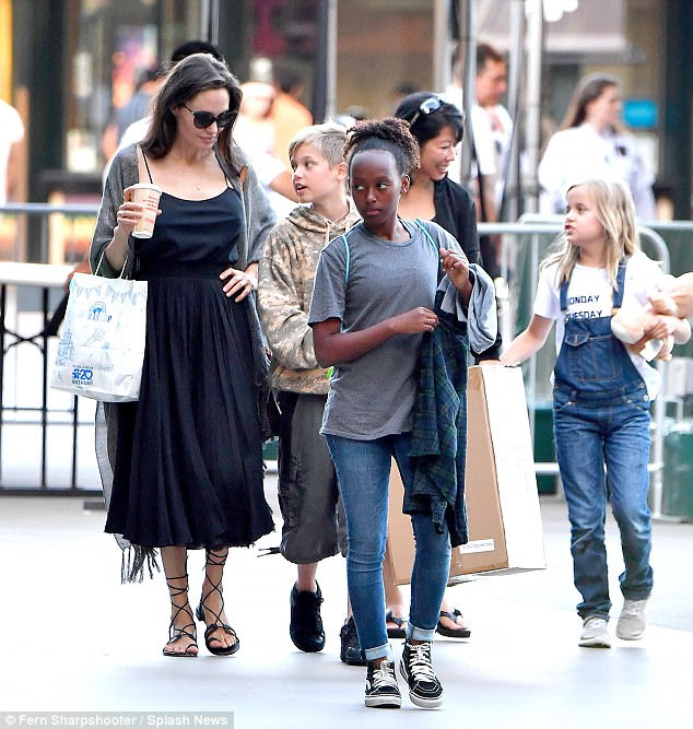 Nice kicks AJ: The mother-of-six opted for a bit of bohemian style for the shopping spree, donning black gladiator sandals