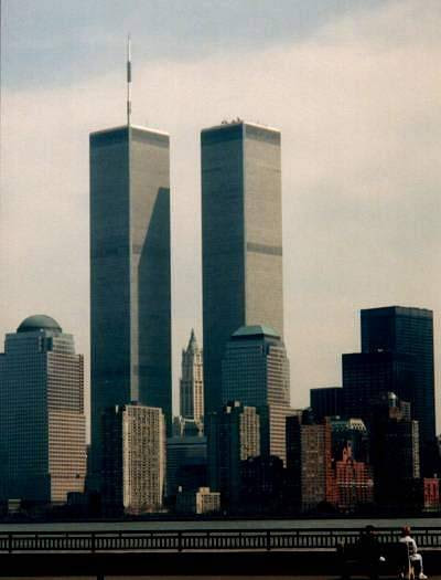"""September 11, 2001 6:30am: I got up for school in a rush.  For some reason all my normal morning routines were thrown off, nothing seemed to be going right for me.  As I realized the strangeness of morning I stopped what I was doing and said out loud """"something bad's gonna happen today."""" Then I was off to catch the bus. 7:30am: First hour photography class, nothing interesting happened. 8:30am: Second hour, little did we know that within the next fifteen minutes a plane was going to come screaming through New York. 9:15am: I'm walking the halls during passing time to get to my next class when I hear chatter about planes crashing into the World Trade Center.  When I get to my third hour class we decide to skip the days lecture and watch the horrors unfold before us on T.V. 10:00am: We watch as the second tower collapses 10:30am: We watch as the first tower collapses For the rest of the school day all classes are watching CNN. 2:12pm: School gets out but buses are being held because the FBI has confirmed terrorist attacks. 3:00pm: I finally make it home only to discover that both my parents were sent home from work because of the events that had taken place.  My family and I watch the news together. 4:00pm: My family and I decide we're going to drive around and watch all the panic stricken people line up by the hundreds to get gas.  We also go to the mall and take pictures of it's empty lot and signs that read """"With respect for family and friends across the country, Jacobson's will close at noon today"""" and """"Laurel Park Place is closed for the rest of today Tuesday, September 11, 2001"""" 5:00pm: Back home we eat dinner in front of the T.V. and I put a VHS tape in the VCR and start recording all the news channels. Last night I watched that tape in tears as I saw people leaping to their death from the Twin Towers.  I sometimes try to put myself in the position of the people on those planes.  What was going through their minds as they were headed straight for one of the tal"""
