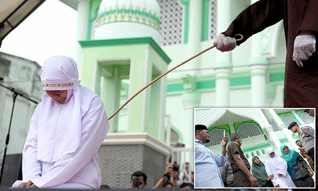 Indonesian woman becomes the latest to suffer public caning under strict Islamic rules