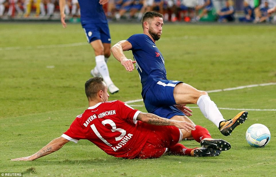 England international Cahill times his challenge perfectly to win the ball off Bayern Munich's goalscorer Rafinha