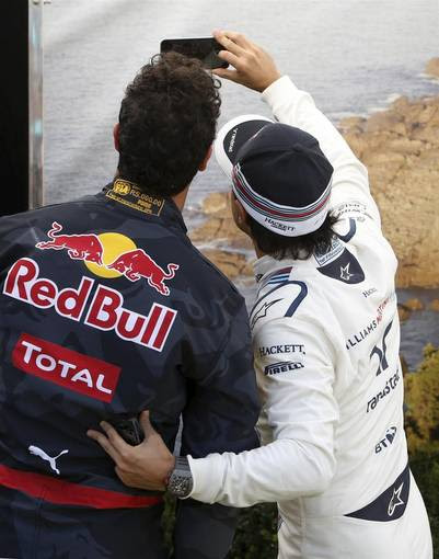 Formula One -  Australia Grand Prix - Melbourne, Australia - 17/03/16 - Williams F1 driver Felipe Massa (R) takes a 'selfie' with Red Bull Racing F1 driver Daniel Ricciardo in between drivers portraits before the Australian Formula One Grand Prix in Melbourne. REUTERS/Brandon Malone