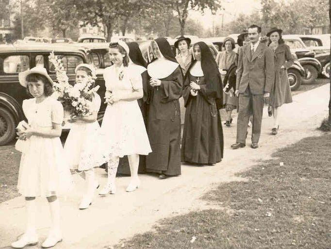 IHM sisters participate in a procession at Christ the