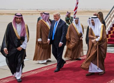 U.S. President Donald Trump (center) is welcomed by Saudi King Salman bin Abdulaziz al-Saud (right) upon arrival at King Khalid International Airport in Riyadh on May 20, 2017 | Mandel Ngan/AFP via Getty Images
