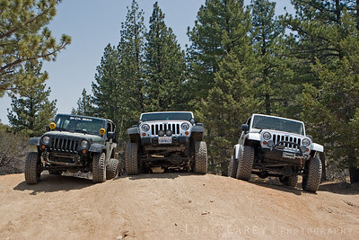 Three jeep wranglers stopped after the difficult section of John Bull