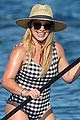 hilary duff wears striped swimsuit for paddle boarding in hawaii 04