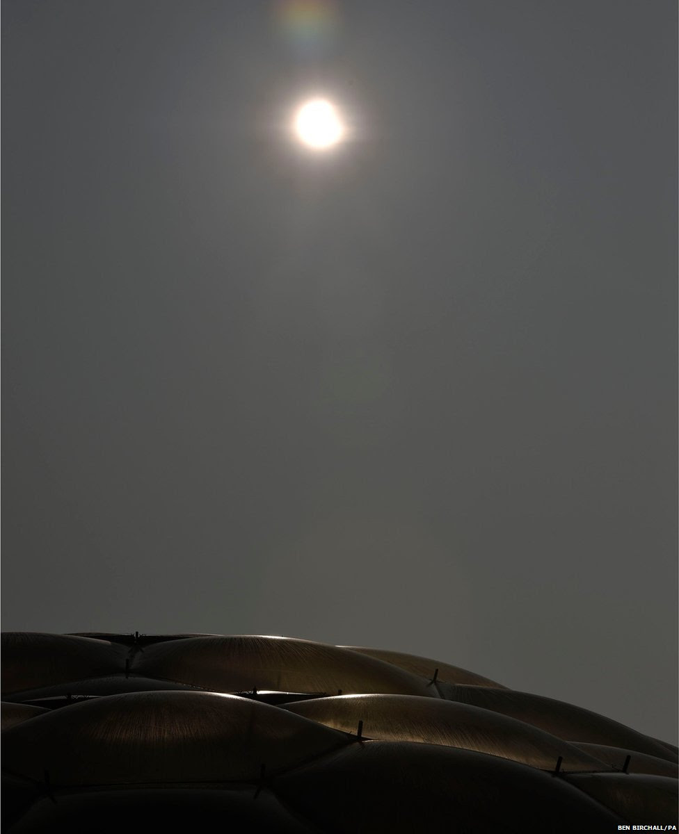 An eclipse of the sun begins over the Eden Project near St Austell in Cornwall, England